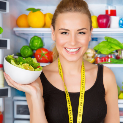 istock Dietitian with fresh salad 498602751