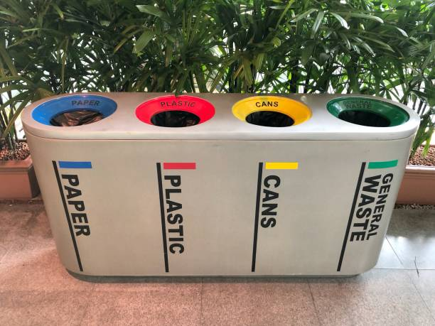 difference colored bins for collection of recycle materials - recycling bin stock photos and pictures