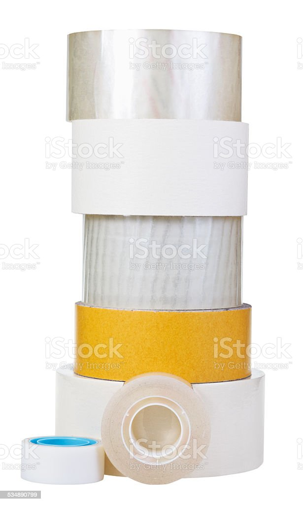 different adhesive tape rolls isolated on white stock photo