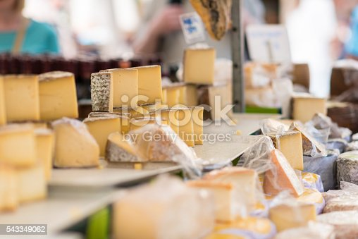 different aged cheese on a market stall