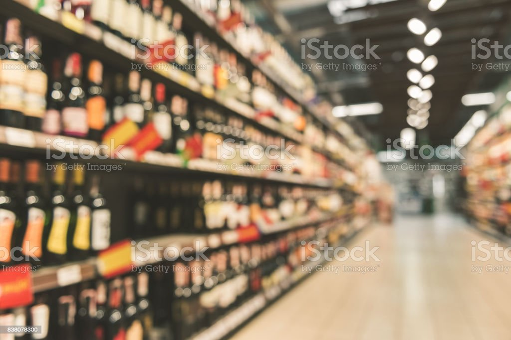 Different alcohol bottles in supermarket stock photo