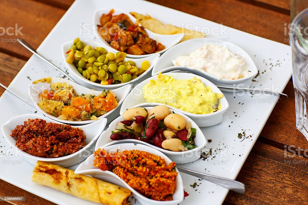 Different appetizer and anti pasti on white plate stock photo