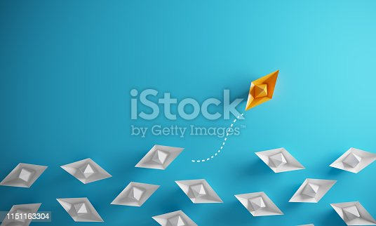 Group of paper boats in one direction and one individual pointing in the different way, can be used leadership/individuality concepts.( 3d render )