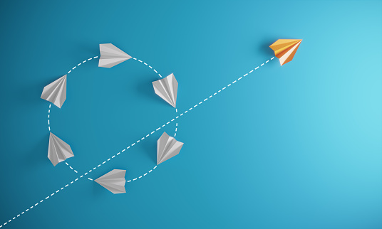 Group of paper airplane in same one direction  and with one individual pointing in the different way, can be used leadership/individuality/innovation concepts.( 3d render )