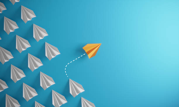 Different Approach - Different Direction Group of paper airplane in one direction and with one individual pointing in the different way, can be used leadership/individuality concepts.( 3d render ) contrasts stock pictures, royalty-free photos & images