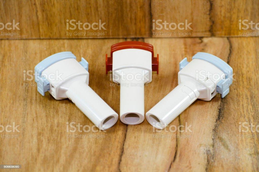 Different Asthma Inhaler on wooden Background stock photo
