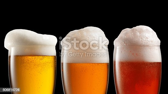 istock Different beer in glasses isolated on black 506814726