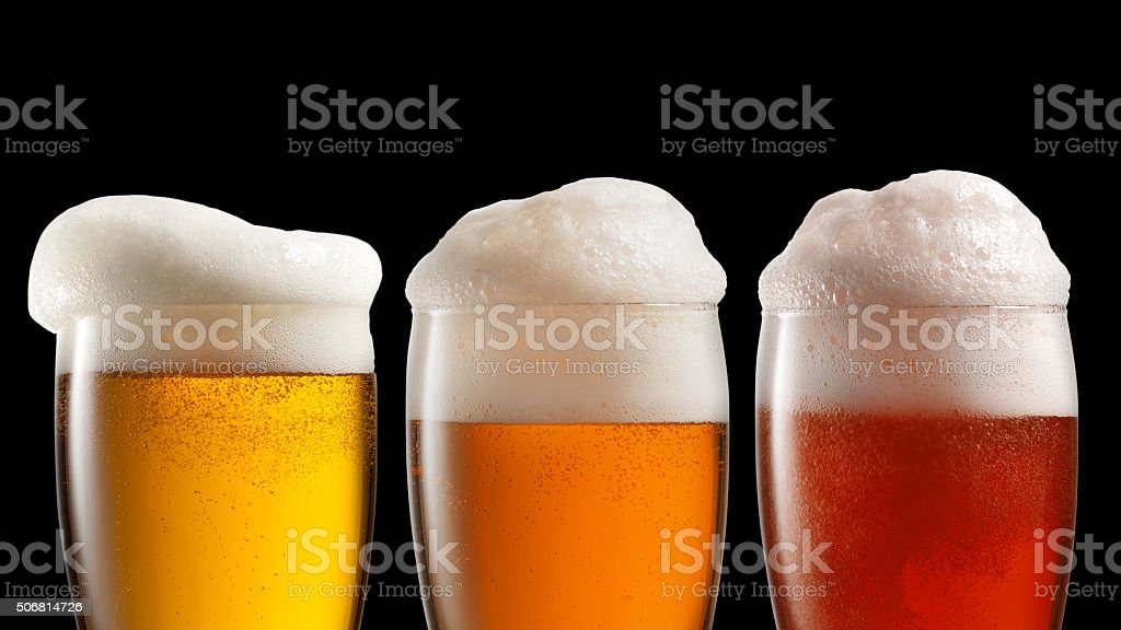 Different beer in glasses isolated on black stock photo