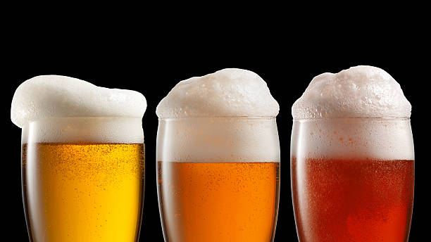 different beer in glasses isolated on black - beer foam stock photos and pictures