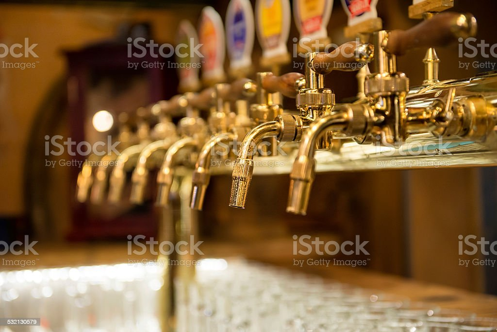Different beer taps in a row stock photo