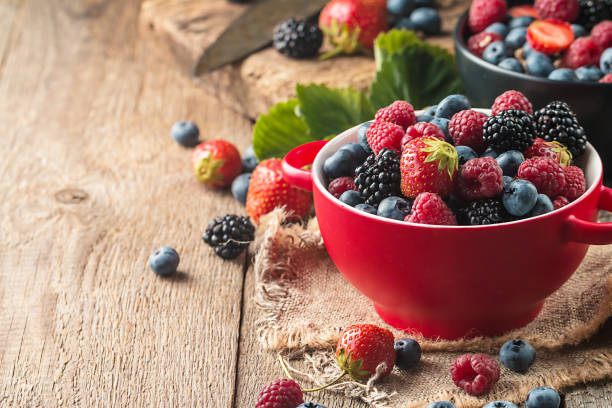 different berries in bowl. - berry stock photos and pictures