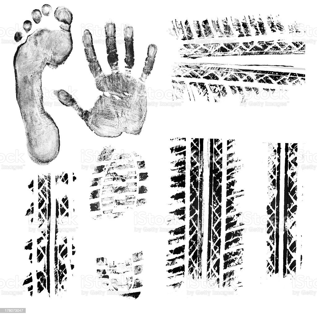 Different black tire track prints and hand and foot prints stock photo