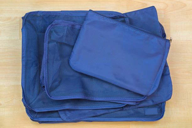 Different blue cube bags, set of travel organizer to help packing luggage easy stock photo