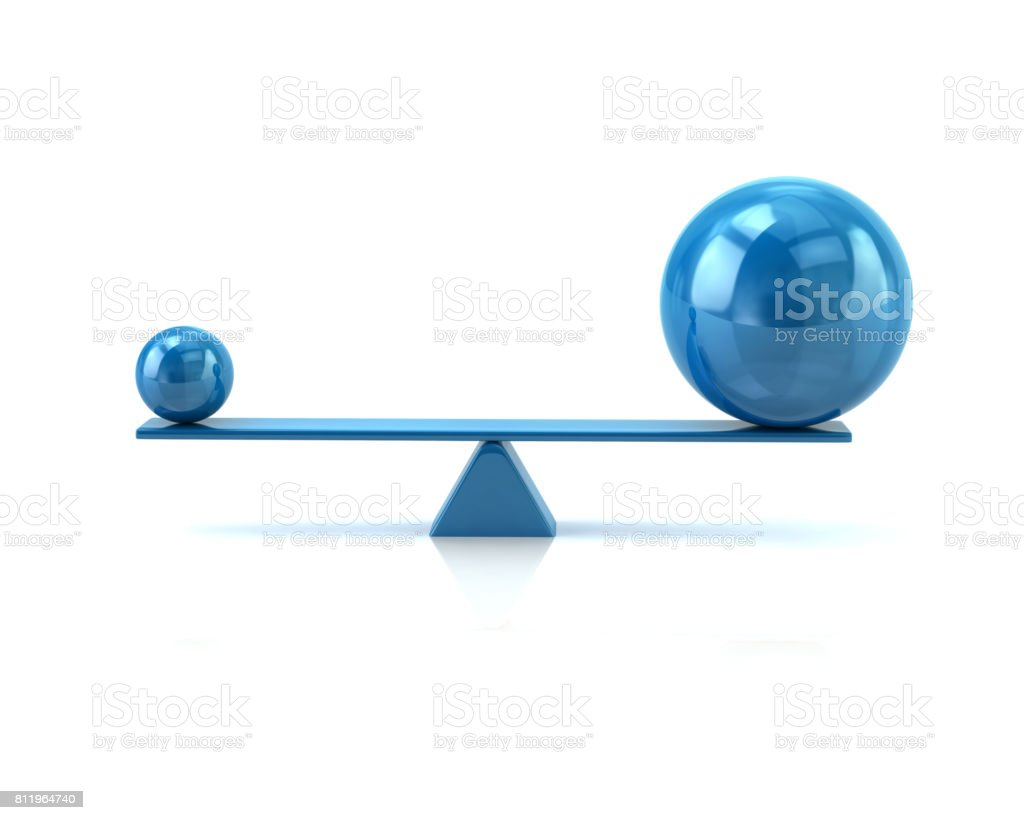 Different blue spheres balancing on a seesaw stock photo