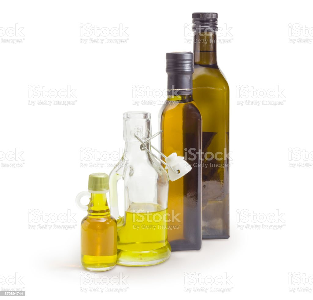Different bottles of the various vegetable oil on white background stock photo