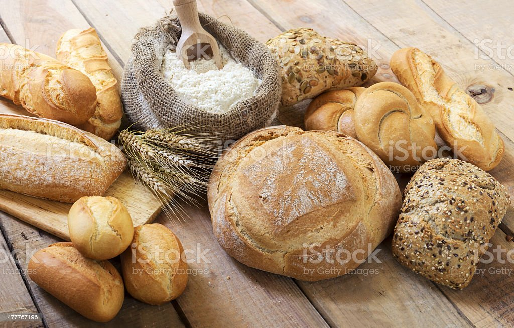 Different bread and bread slices. stock photo