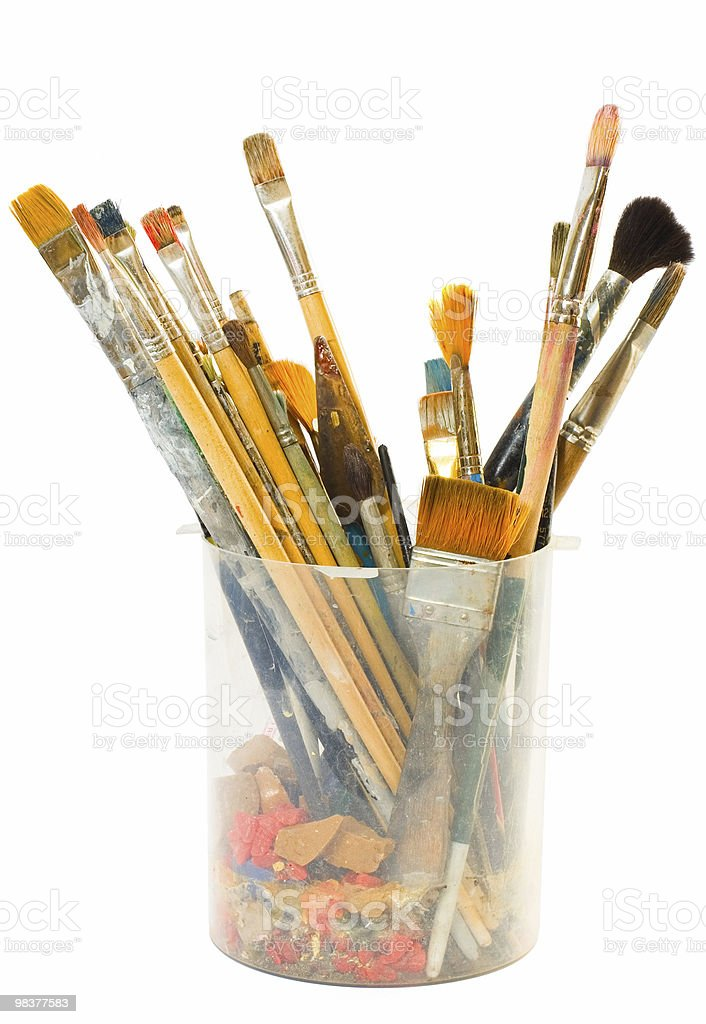 Different brushes in a jar on a white background royalty-free stock photo