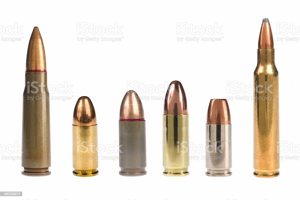 6 different bullets standing on a white background A selection of bullets isolated on white. Ammunition Stock Photo