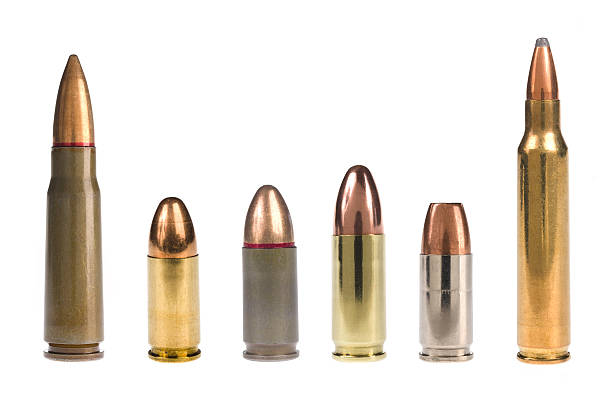 6 different bullets standing on a white background A selection of bullets isolated on white. ammunition stock pictures, royalty-free photos & images