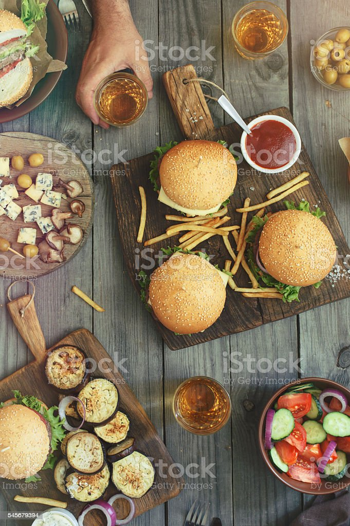 Different burgers and beer stock photo
