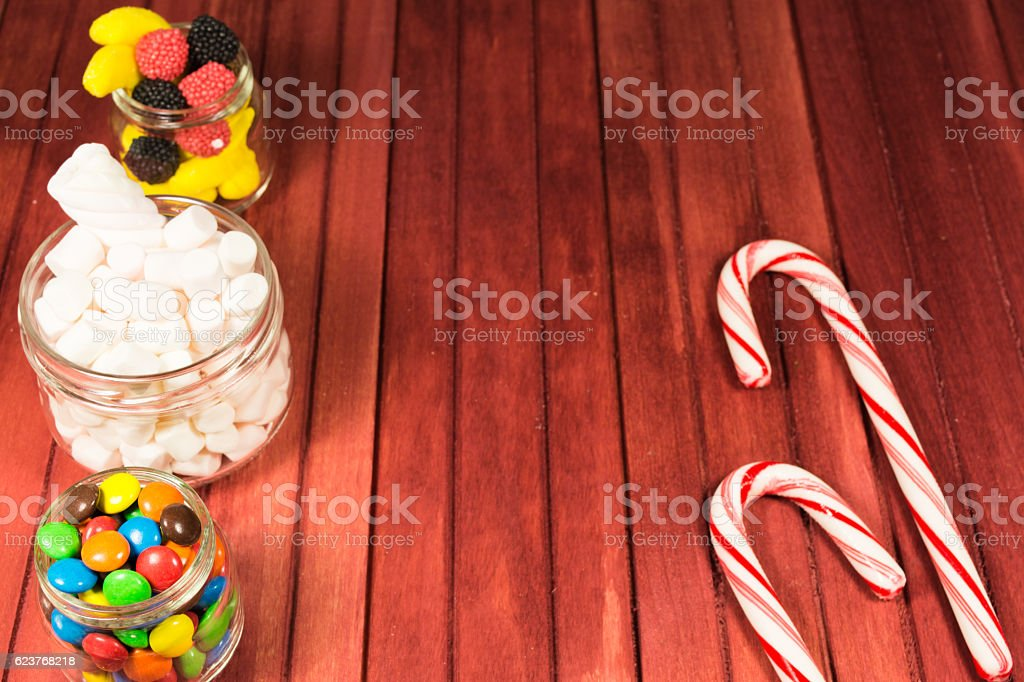 Different candies on wooden background stock photo