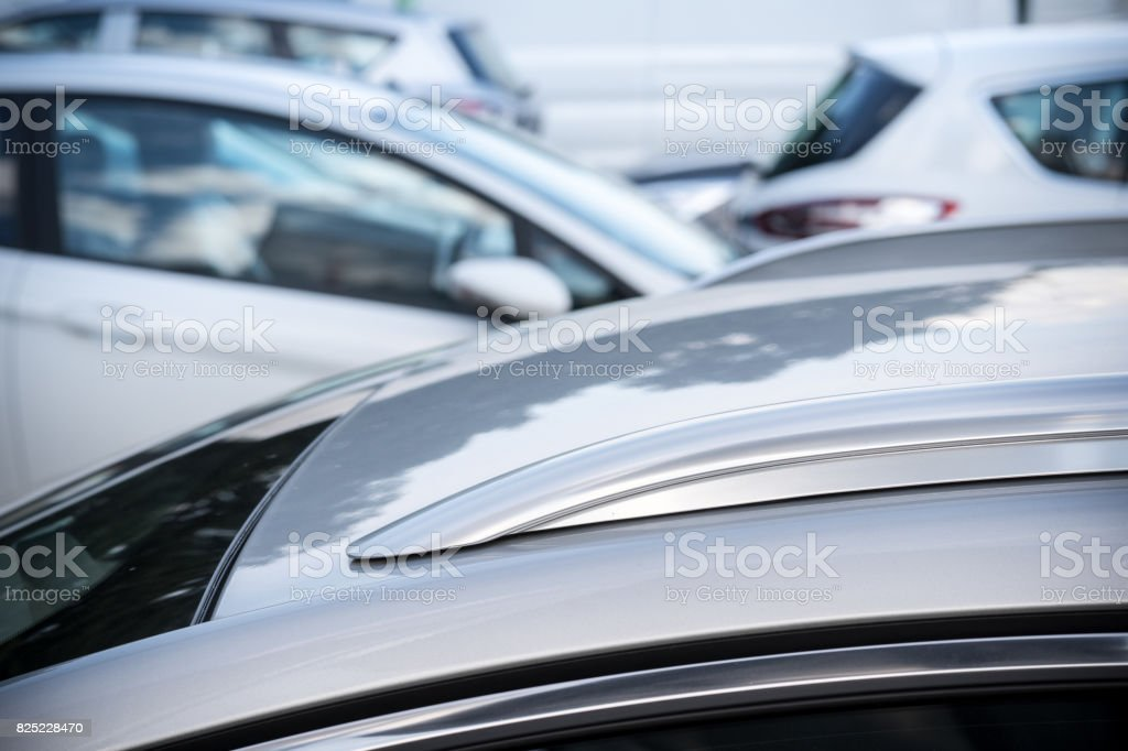 Different cars on a public parking lot stock photo