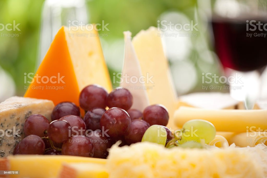 different cheese with grapes close royalty-free stock photo