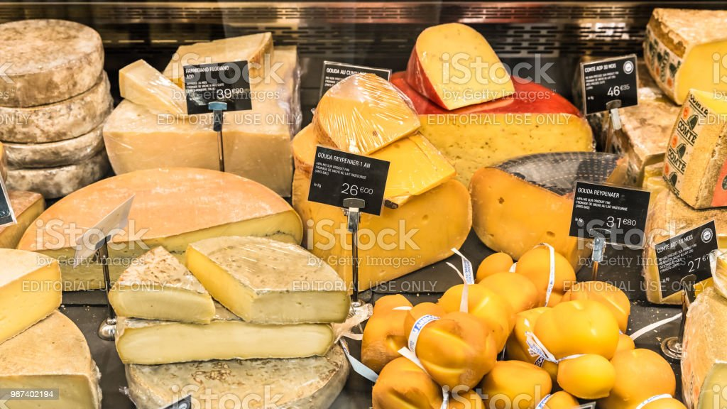 different cheeses on display in a supermarket paris france stock rh istockphoto com