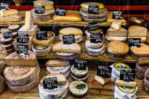 Different cheeses on the counter of a small store at the Aligre Market. Paris, France stock photo