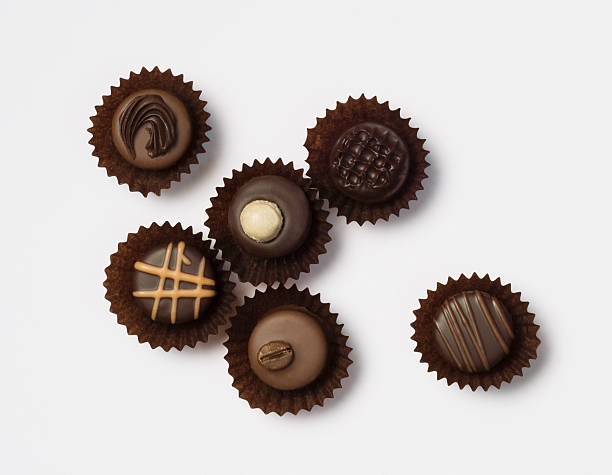 Different chocolate pralines on white background stock photo