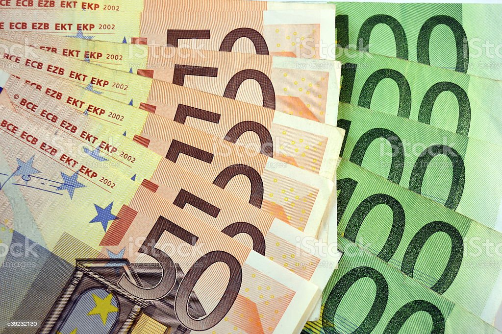 Diferentes Fechar-se de banco nota e moedas de EURO foto royalty-free