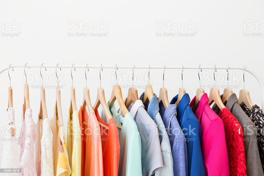 Different clothes on the rack stock photo