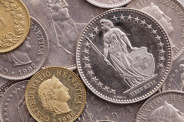 Different coins of Swiss money stock photo