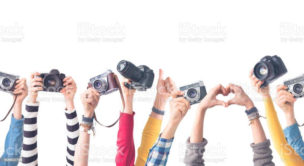 Andere Farbe Hände halten Kameras – Foto