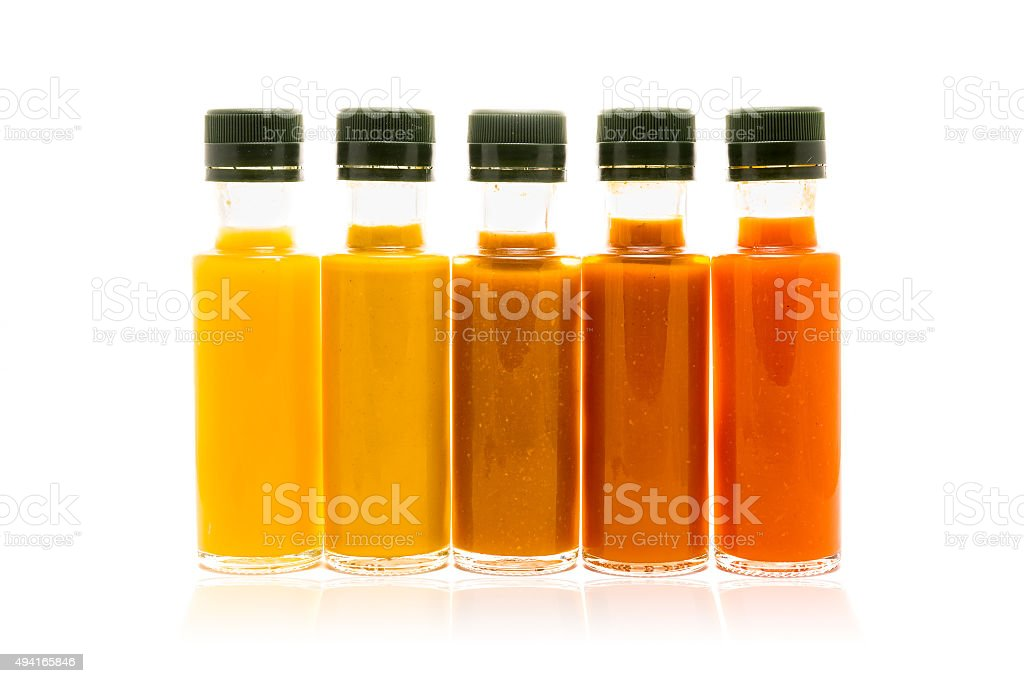 Different color home made hot sauce in glass bottles stock photo