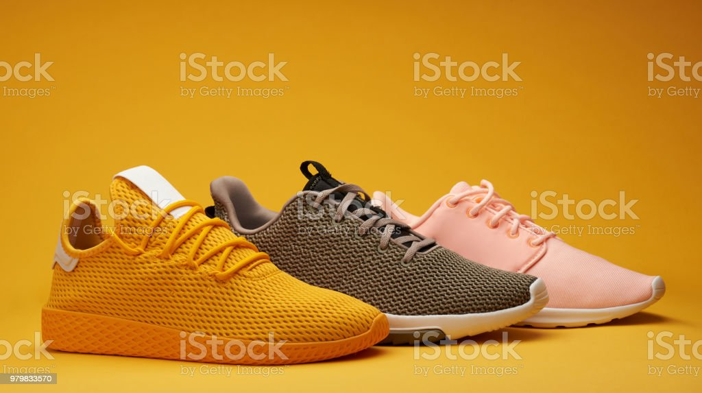 Different color running shoes stock photo