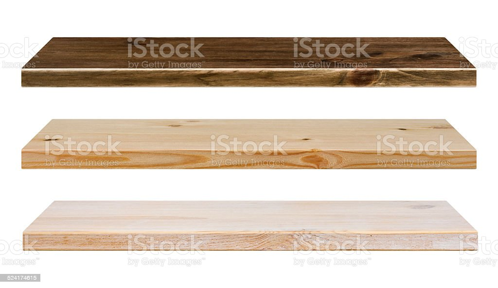 Different color wooden shelves isolated on white stock photo