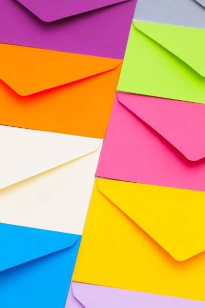 different colored envelopes - address book stock photos and pictures