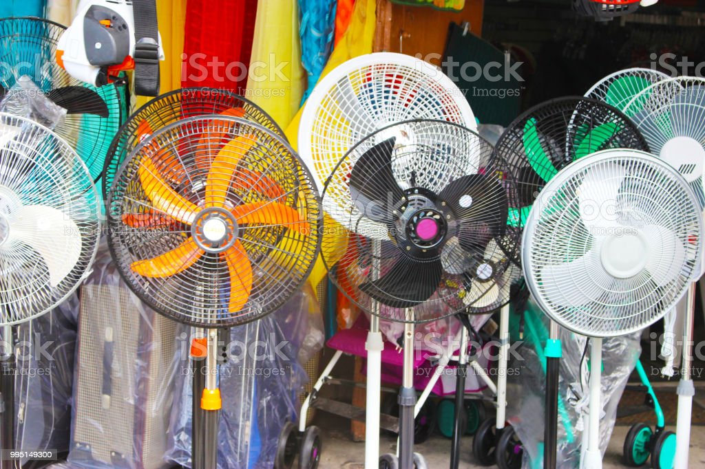different colored fans for sale on street royalty-free stock photo