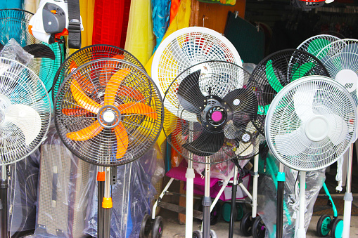 Different Colored Fans For Sale On Street Stock Photo - Download Image Now