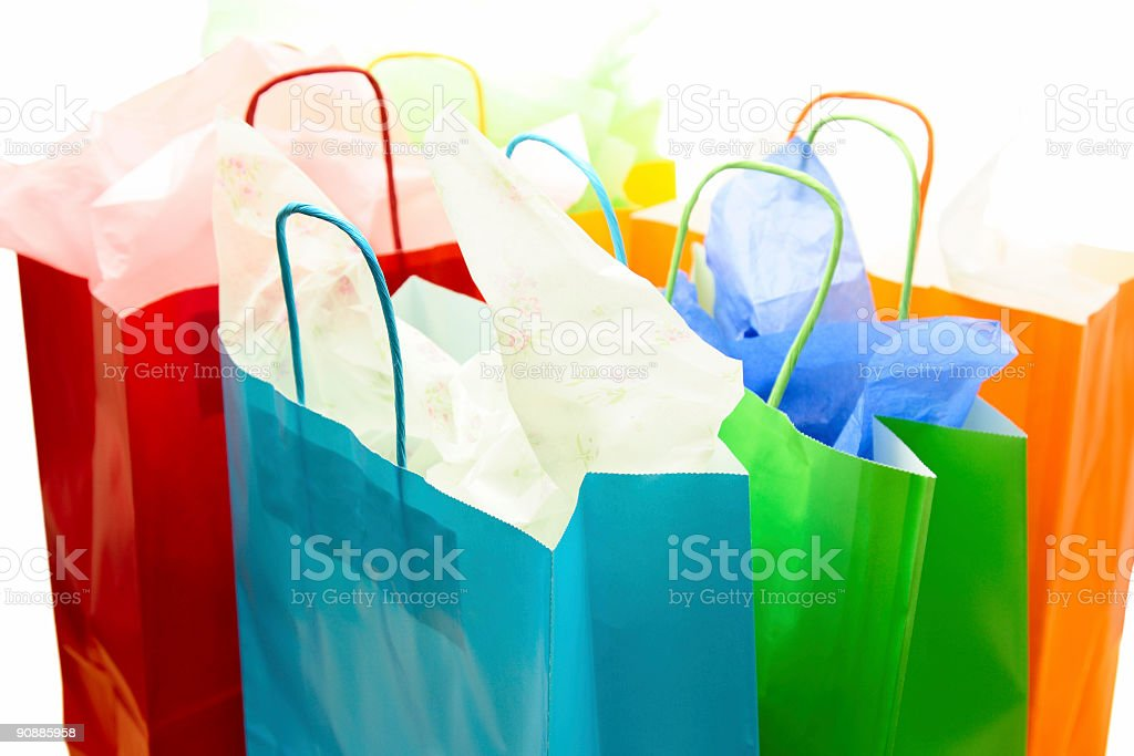 Different colored gift bags filled with tissue paper royalty-free stock photo