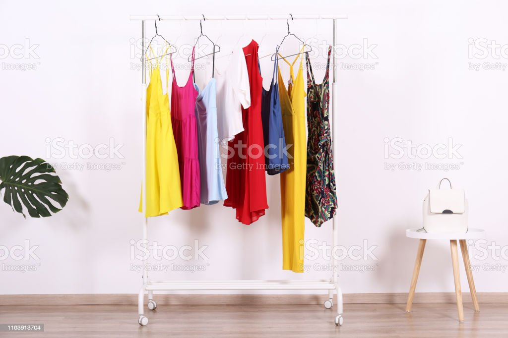 Women\'s hip clothing store interior concept. Row of different...