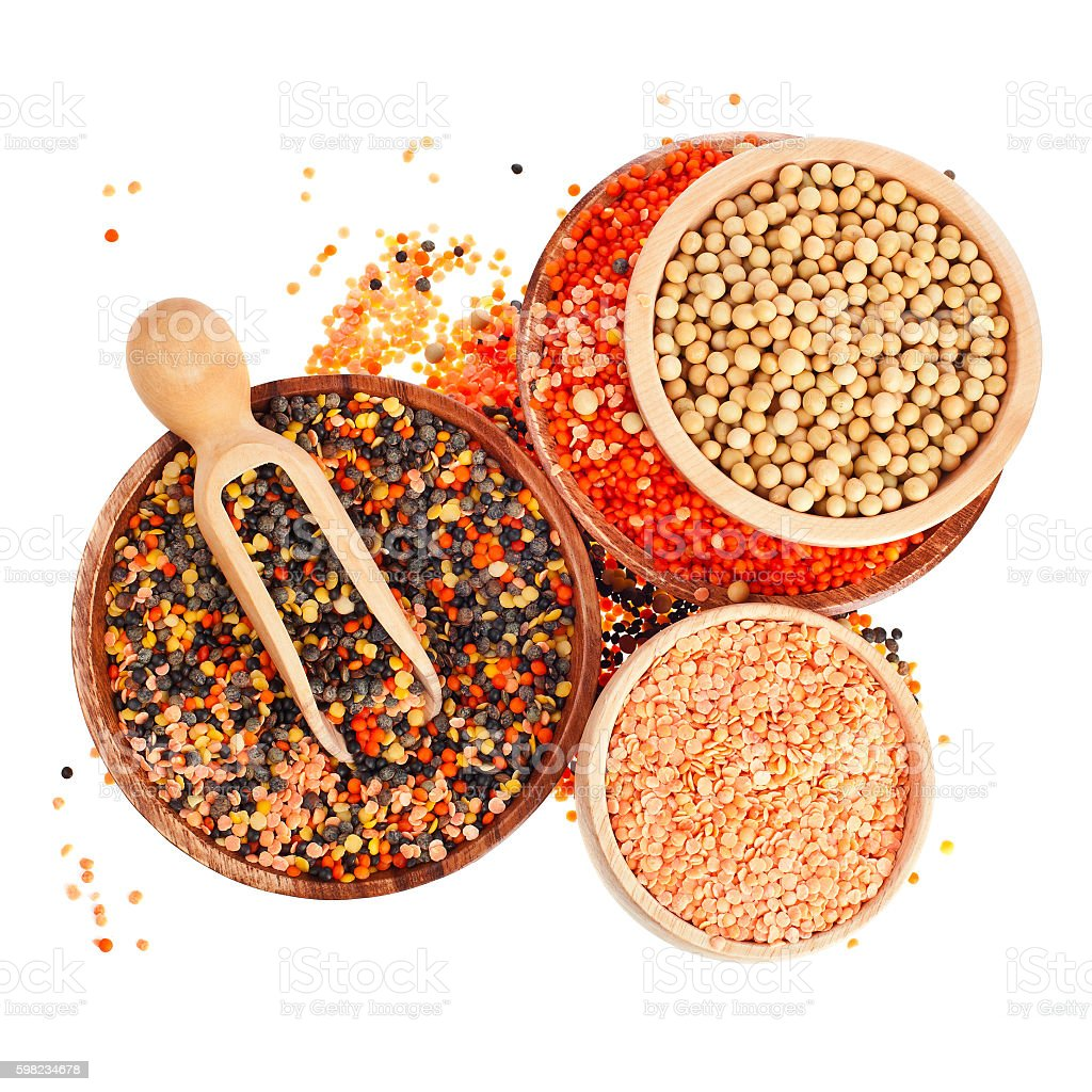 Different colorful lentils in a wooden bowls foto royalty-free