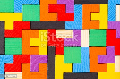 istock Different colorful shapes wooden blocks pattern background. Top view 1167625978