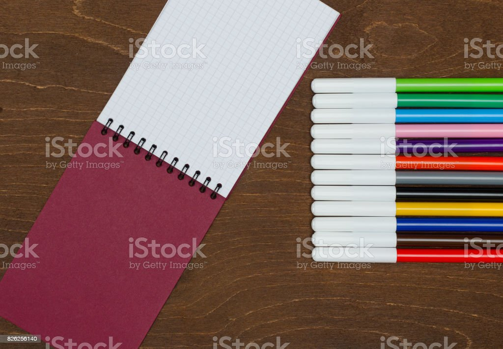 Different colors markers and notebook stock photo