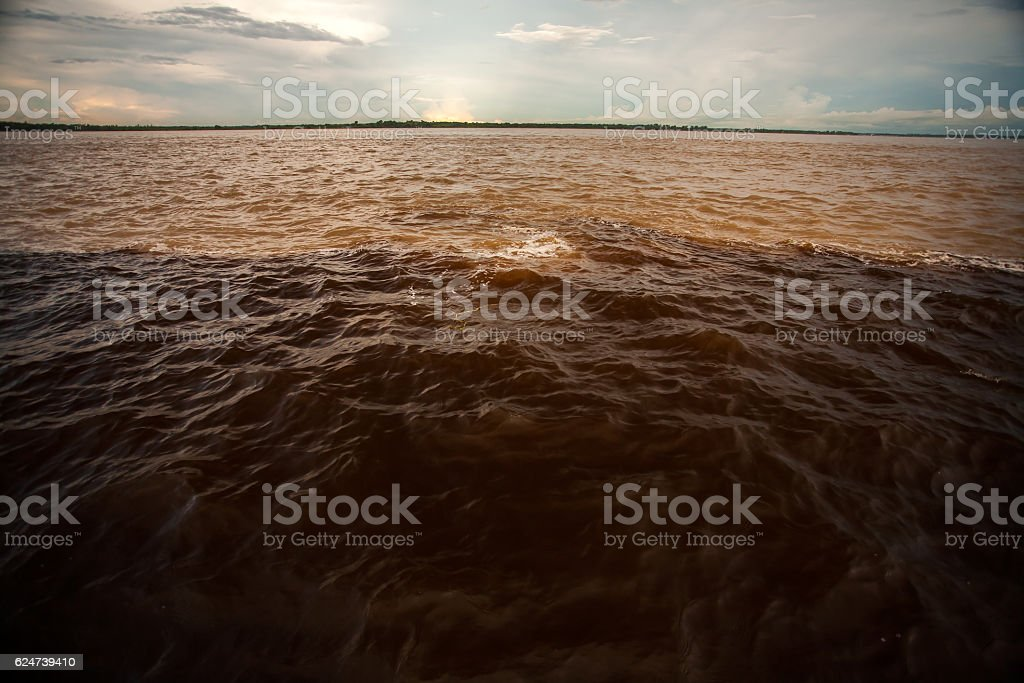 Different colors water meeting Black and Solimoes river Manaus Amazon stock photo