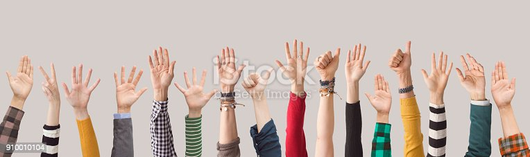 istock Different colour arms up on gray background 910010104