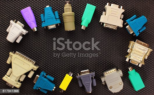 istock Different computer connectors and adapters on black background. 517341366