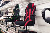 istock Different computer gamer soft ergonomic chairs in the furniture store 1284210443