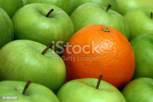 istock different concepts - orange between apples 91691562